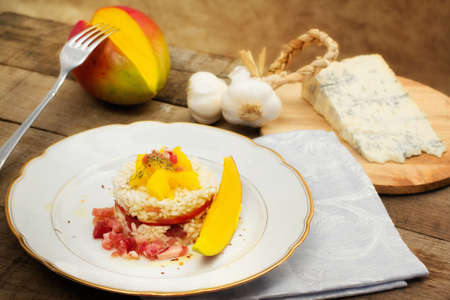 risotto with mango and gorgonzola cheese photo