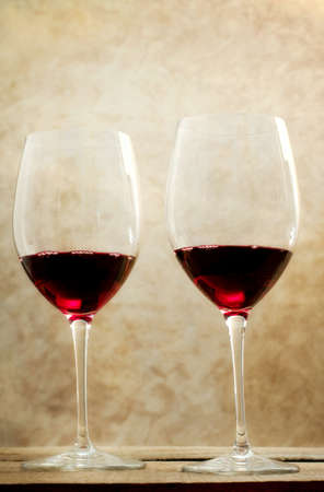 red wine glasses over neutral background photo