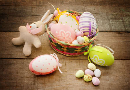 easter concept with easter eggs and bunny puppet photo
