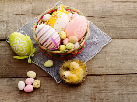 easter concept with chocolate eggs and  chichekn photo