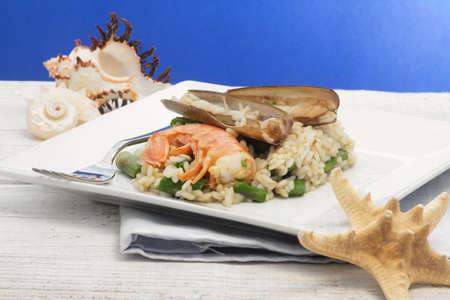 risotto with asparagus, razor shell and prawn photo