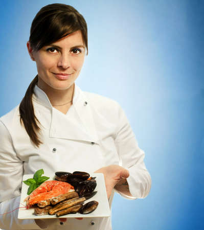 female chef with frozen seafood photo