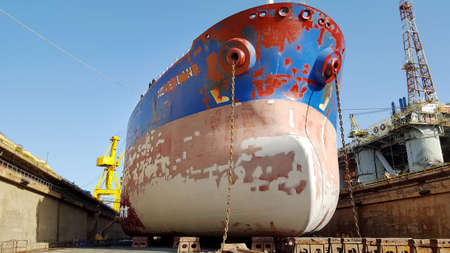 drydock: painting of a ship hull at drydock Stock Photo