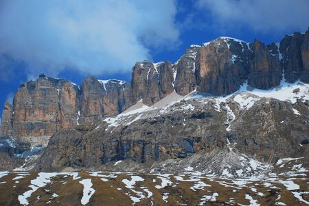 sella: A snow-capped mountain cliff in the famous Passo di Sella mountain pass in the western Italian Dolomites