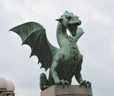Statue of a dragon guarding the Ljubljana Dragon Bridge in Slovenia photo