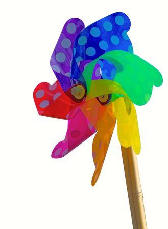 innocense: Colorful toy weathervane - Isolated on White Stock Photo