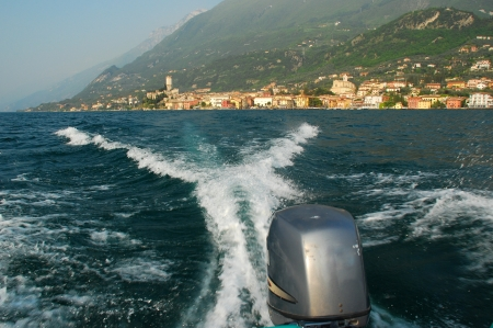 range of motion: Rear view from a speedboat on Lake Garda Lago di Garda in Italy Stock Photo