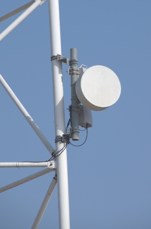 microwave antenna: Microwave antenna dish on blue background
