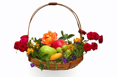 Colorful basket of fruit decorated with flowers isolated on white