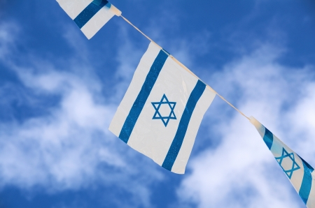 Israeli flags showing the Star of David hanging proudly Standard-Bild