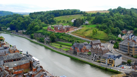 meuse: Old city and nature coming together in a wide-open panoramic view   The River Meuse valley with the town of Dinant below