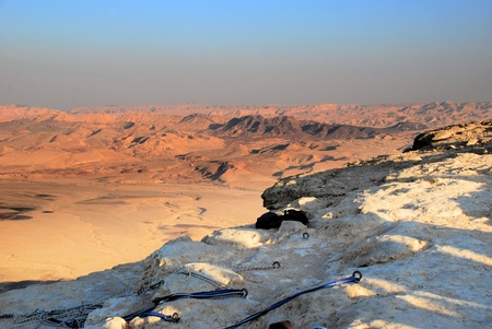 rappeling: Abseiling anchors and rope ready to carry climbers descending into the Makhtesh Ramon  crater  with sunset light in the Israel Negev desert