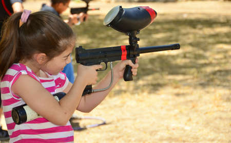 Target practice with a paintball gun Stock Photo