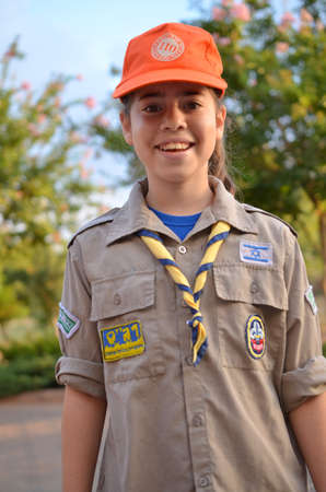 A happy Israel Girl Scout - Zofim - on the way to summer camp photo