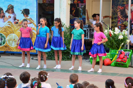jewish group: Israeli secular school children celebrating the Jewish holiday of Shavuot (Feast of Weeks) commemorating the harvest, the Day of the First Fruits, and the day the Torah was traditionally revealed by God to the Israelites