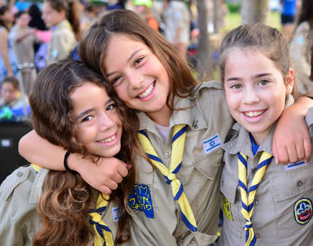 Happy Israel Girl Scouts - Zofim - on the way to summer camp Editorial
