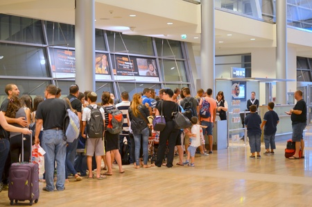 Passengers standing in line at the gate of Tel Aviv Airport  TLV or Ben Gurion Airport  on their way to summer vacation on August 18, 2013 in Tel Aviv, Israel