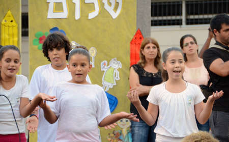 KFAR SABA, ISRAEL - AUGUST 25  Unidentified children aged 11-12 performing in a back-to-school welcome ceremony for first graders on August 25, 2013 in Kfar Saba, Israel
