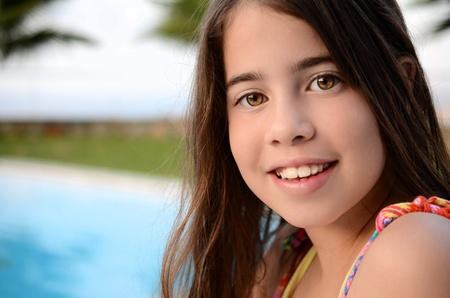 11 year old girl: Portrait of a teenage girl by the pool - 11 year old girl enjoying the summer vacation by the pool on the Greek island of Crete Stock Photo