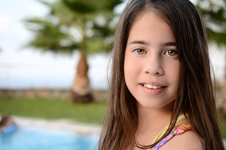 11 year old: Portrait of a teenage girl by the pool - 11 year old girl enjoying the summer vacation by the pool on the Greek island of Crete Stock Photo