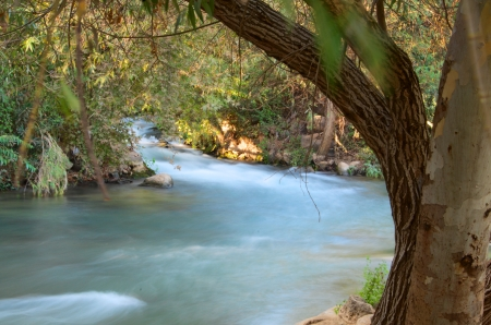 Jordan River - Jordan River at the Hazbani, one of the streams feeding the main Jordan in the North of Israel photo