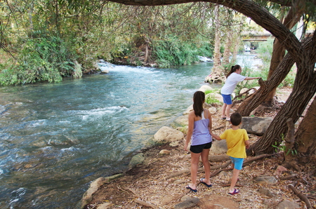 Sisters and Brother on the Jordan River - Jordan River at the Hazbani, one of the streams feeding the main Jordan in the North of Israel