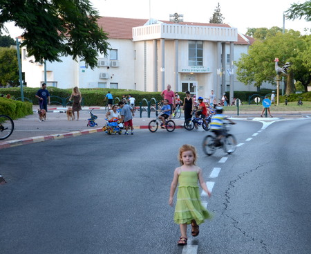 israelis: KFAR SABA, ISRAEL - SEPT 14: People celebrating Yom Kippur (Day of Atonement) on Sept. 14, 2013 in Kfar Saba, Israel.  There is no car travel and Israelis freely bicycle and skate on the streets.
