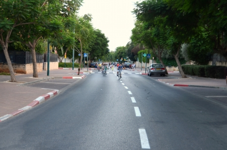 KFAR SABA, ISRAEL - SEPT 14: People celebrating Yom Kippur (Day of Atonement) on Sept. 14, 2013 in Kfar Saba, Israel.  There is no car travel and Israelis freely bicycle and skate on the streets.