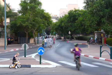 kippur: KFAR SABA, ISRAEL - SEPT 14: People celebrating Yom Kippur (Day of Atonement) on Sept. 14, 2013 in Kfar Saba, Israel.  There is no car travel and Israelis freely bicycle and skate on the streets.