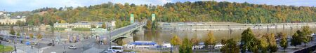 foiliage: PRAGUE, CZECH REPUBLIC - OCT  13: Traffic on and by the Prague River Vltava and the Chekhov Bridge, Czech Republic.  The Vltava River is the longest river in the country and it crosses Prague in its heart.