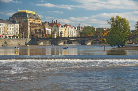 foiliage: PRAGUE, CZECH REPUBLIC - OCT  13: Boats on the Prague River Vltava and the Manesuv Bridge, Czech Republic.  The Vltava River is the longest river in the country and it crosses Prague in its heart.