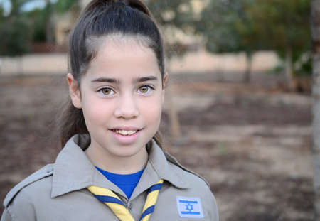 A happy Israel Girl Scout on the way to summer camp photo