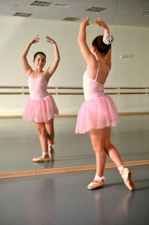 Portrait of a teenage girl ballet dancer in the mirror photo