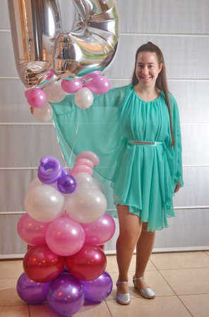 sweet sixteen: Young woman all dressed up in a teal dress for her Sweet Sixteen party