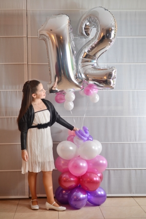 bar mitzvah: Secular 12-year-old Israeli teenager celebrating her Bat Mitzvah with special balloons Stock Photo