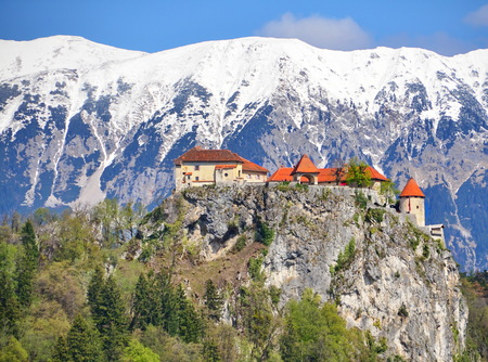 Bled castle, Slovenia with snow-capped mountains overlooking Lake Bled