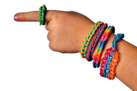 Little boy wearing colorful loom band rubber bracelets and ring (isolated  on white)