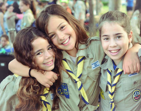 Happy Israel Girl Scouts on the way to summer camp  KFAR SABA, ISRAEL - JULY 19  Three unidentified Israel Scouts members aged 11-12 happy and excited upon leaving for summer camp on July 19, 2013 in Kfar Saba, Israel   vintage-processed