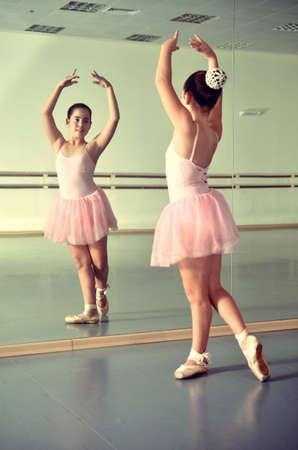 ballet bar: Portrait of a teenage girl ballet dancer in the mirror Girl Scout  vintage-processed