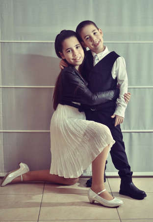 secular: Secular 12-year-old Israeli teenager celebrating her Bat Mitzvah with her younger brother  vintage-processed