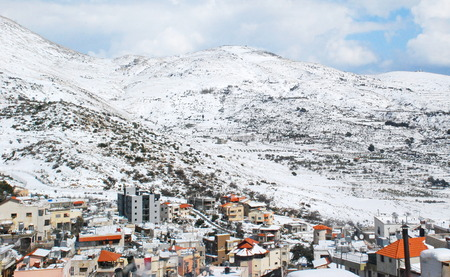 Mount Hermon and the Druze village of Majdal Shams in the Golan Heights in Northern Israel covered in snow