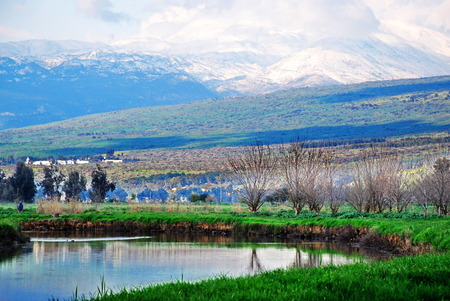 Hula Lake nature reserve in the Galilee and snow-capped Mount Hermon in the Golan Heights in Northern Israel Stock Photo