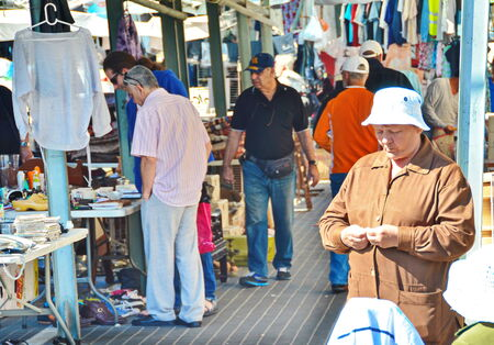yamaka: JAFFA, ISRAEL - APR 11, 2014: Unidentified people shopping on Friday morning at the Flea Market in the old city of Jaffa, Tel Aviv, Israel