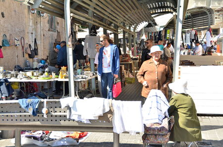 JAFFA, ISRAEL - APR 11, 2014: Unidentified people shopping on Friday morning at the Flea Market in the old city of Jaffa, Tel Aviv, Israel