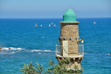 Views of the Mediterranean with a tower and sailing boats from  Jaffa, Tel Aviv, Israel photo