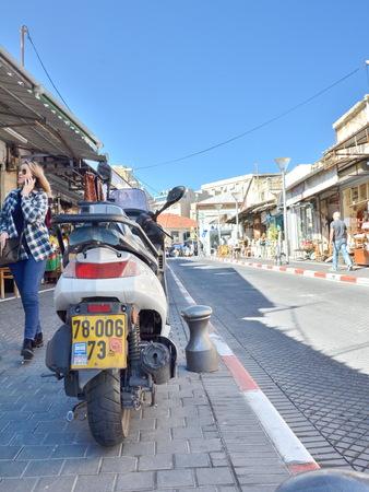 yafo: JAFFA, ISRAEL - APR 11, 2014: Scooter and people in Flea Market in the old city of Jaffa, Tel Aviv, Israel Editorial