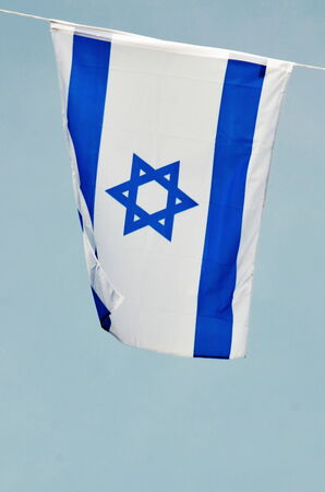 yom: Israel flag in white and blue showing the Star of David hanging proudly for Israels Independence Day (Yom Haatzmaut)
