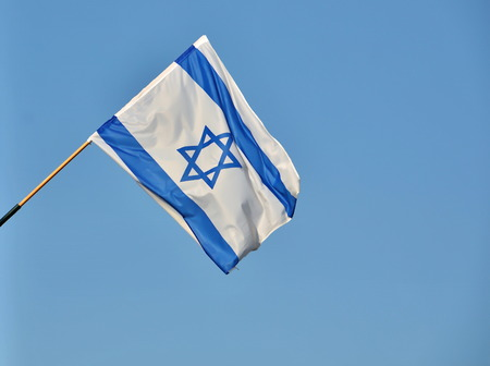 Israel flag in white and blue showing the Star of David hanging proudly for Israels Independence Day (Yom Haatzmaut) photo