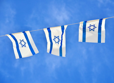 Israel flags in a chain in white and blue showing the Star of David hanging proudly for Israels Independence Day (Yom Haatzmaut)