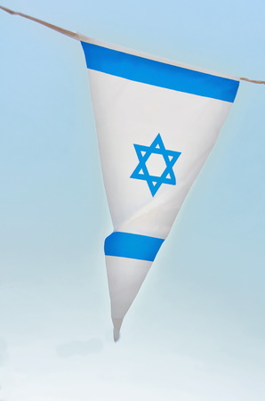 jewish ethnicity: Triangle Israel flags in a chain in white and blue showing the Star of David hanging proudly for Israels Independence Day (Yom Haatzmaut)